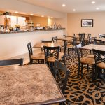 breakfast room buffet and seating at Best Western Executive Inn & Suites