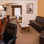 king room livng room wih sofa and tables at Best Western Executive Inn & Suites